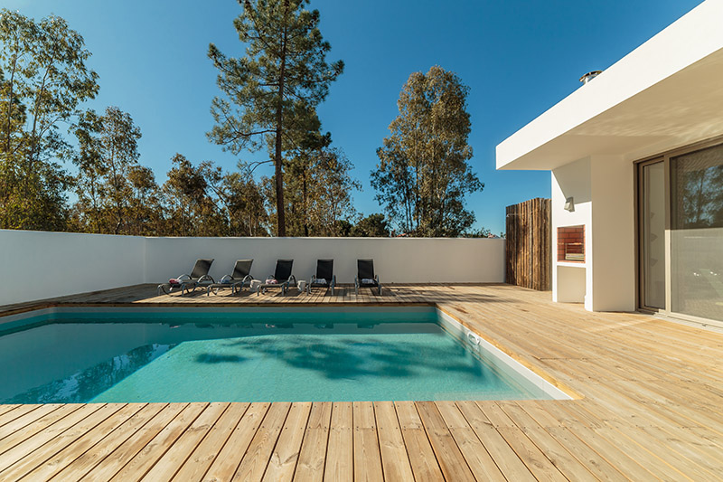 Modern,House,With,Garden,Swimming,Pool,And,Wooden,Deck